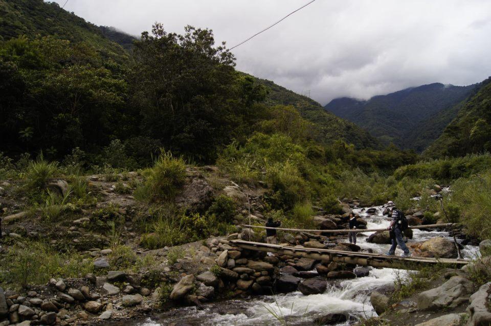 Me crossing the Amazon river in Baños, Ecuador